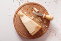 Parmesan cheese top view of on a wooden board Royalty Free Stock Photo
