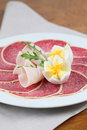 Parmesan crust salami with ham and eggs Royalty Free Stock Images