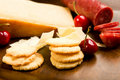 Parmesan shortbread biscuits and salami Stock Photos