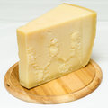 Parmigiano slice of famous italian cheese Royalty Free Stock Photo