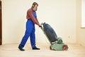 Parquet floor maintenance by grinding machine carpenter doing wood polishing work Stock Image