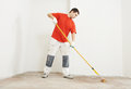 Parquet layer with roller priming floor Royalty Free Stock Photo