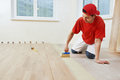 Parquet worker adding glue on floor Royalty Free Stock Photo