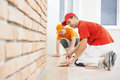 Parquet workers at flooring work two carpenter installing wood board during Royalty Free Stock Photos