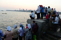 Parsi rituals a group of people respectfully doing at the sea side of mumbai the parsis are an immigrant community possibly coming Royalty Free Stock Images
