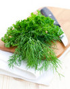Parsley and dill on cutting board Royalty Free Stock Photos