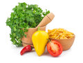 Parsley in mortar and pasta Stock Image