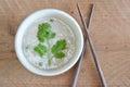 Parsley on rice porridge and wood chopstick table Royalty Free Stock Photos