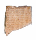 Part of an ancient greek inscribed stele fragment from eleusis attica isolated Royalty Free Stock Photography