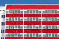 Part of building with red balconies and double glazi Royalty Free Stock Photo