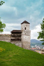 The part of castle's wall with turret clock in Trencin Royalty Free Stock Photo