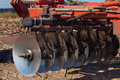 Part of the cultivator, steel, round discs in a row. Royalty Free Stock Photo