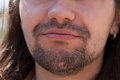 Part of face young European man with beard. Royalty Free Stock Photo