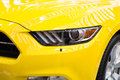 Part of front end of a yellow sports  car Royalty Free Stock Photo