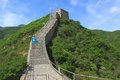 Part of the great wall second scenic spot badaling china image at with red blue and green flags on Stock Image
