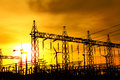 Part of high voltage substation at sunset. Royalty Free Stock Photo