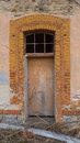Part of the old building with door. Royalty Free Stock Photo