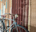 Part of old classic bicycle parked near vintage style wall at the corner with copyspace to input text used as template Stock Photography