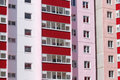 Part of pink residential building with red balconies and dou Royalty Free Stock Photo