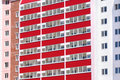 Part of pink residential building with red balconies  at sun Royalty Free Stock Photo