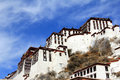 The part of the Potala Palace, with the people republic of China flag inside as well as many windows, curtain, Brick wall, Potala Royalty Free Stock Photo