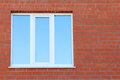 Part of red brick wall and blue window with double glazing building Stock Photo