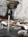 Broken pipe emanating water Royalty Free Stock Photo