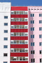 Part of residential building with red balconies at sunny da Royalty Free Stock Photo