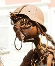 Rusty Iron Girl welded of iron scrap material Royalty Free Stock Photo