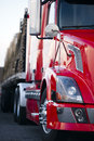 Part of semi truck modern red cabin trailer on parking lot light Royalty Free Stock Photo