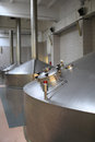 Part of stainless fermentation vats at a brewery Royalty Free Stock Photography