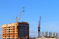 Part of tall cranes and building Royalty Free Stock Photo