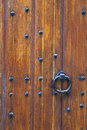 Part of thick very old wooden door of church or medieval buildin Royalty Free Stock Photo