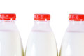 Part of three bottles of milk with cap isolated Stock Photography
