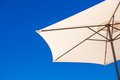 Part of white umbrella on background blue sky at the beach see my other works in portfolio Royalty Free Stock Images