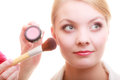 Part of woman face applying rouge blusher makeup detail cosmetic beauty procedures and makeover concept closeup with brush Royalty Free Stock Images