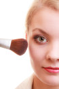Part of woman face applying rouge blusher makeup detail cosmetic beauty procedures and makeover concept closeup with brush Stock Photography