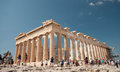 Parthenon of athens acropolis hill august tourists at the famous enjoying monument at august in greece Stock Photo