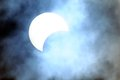 Partial solar eclipse on a cloudy day Royalty Free Stock Images