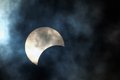 Partial solar eclipse on a cloudy day Royalty Free Stock Photography