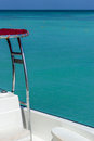 Partial View of Boat with Crystal Blue Ocean Water in the Background Royalty Free Stock Image