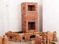 Partially built masonry heater traditional with bricks around it Royalty Free Stock Photos