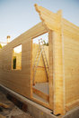 Partially constructed wooden house a wood fir prefabricated block on a domestic building site the front door can in the foreground Stock Photos