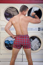 Partially Dressed In the Laundromat Royalty Free Stock Photo