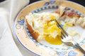 Partially eaten breakfast eggs bread decorative plate Stock Image