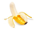 Partially peeled banana Stock Images
