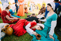 Participants of festival of medieval culture resting in shadow t Royalty Free Stock Photo