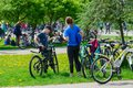 Participants of mass spring bike ride, dedicated to opening of cycling season 2019, after end of event in recreation area, Gomel Royalty Free Stock Photo
