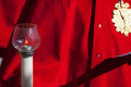 Particular of a candelabrum in front red coat Stock Photo