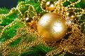 A particular of a Christmas tree with decorations. Royalty Free Stock Photo